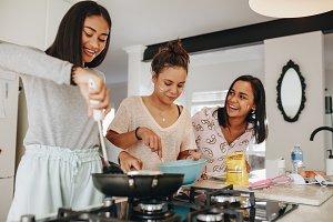 Three girls making food together