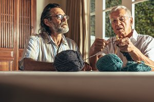 Active seniors knitting at home