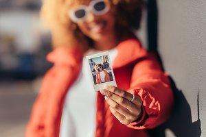 Portrait of a tourist woman holding