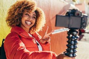 Female tourist recording content