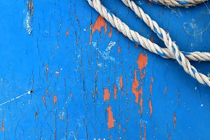 Blue painted wood texture with rope