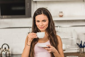 beautiful cheerful woman holding cup