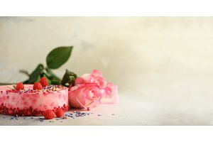 Pink roses and raspberry cake with