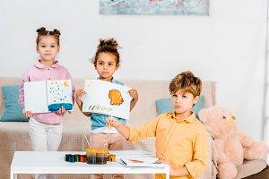 adorable multiethnic children holdin