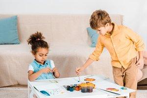 beautiful multiethnic children paint