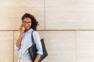 Modern businesswoman at wall