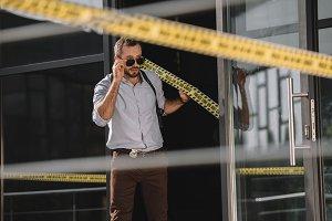 male detective straightening sunglas