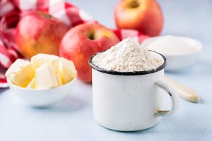 Cup of flour, butter, red apples