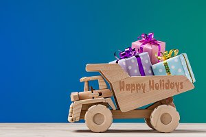 Wooden dump truck with gifts.