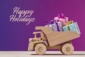 Toy dump truck with gifts.