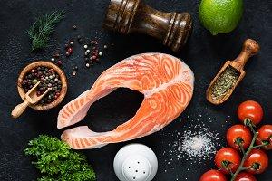 Raw salmon steak, vegetables, spices
