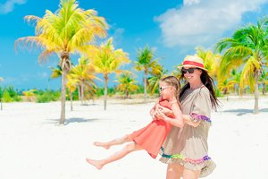 Little cute girl and young mother at