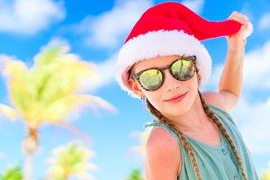 Portrait of little girl in Santa hat