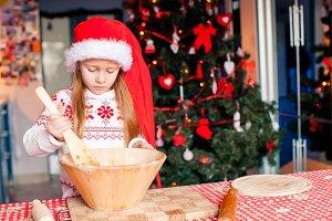 Adorable little girl baking Christma
