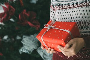 Young woman holds Christmas gift