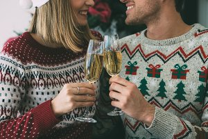 Young woman and man toast on Christm