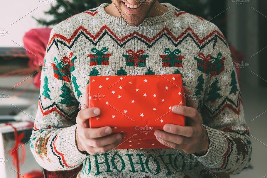 Young Man Opens Christmas Gift Holidays