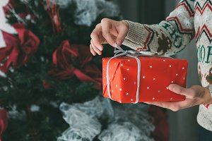 Young man hands opens Christmas gift