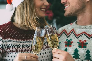 Young man and woman toast on Christm
