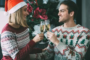 Young couple toasting on Christmas