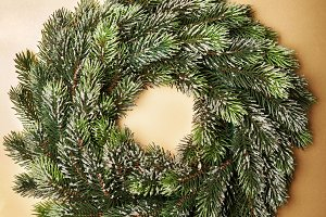 Christmas wreath on brown background