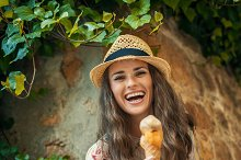 happy trendy tourist woman in Pienza