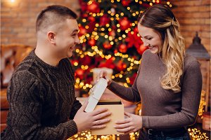 husband gives his wife christmas