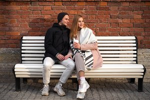 Happy couple sitting on the bench