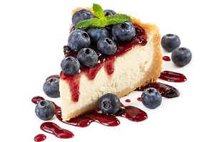 Piece of cheesecake with blueberries
