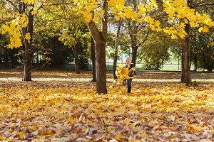 a boy kicks foliage