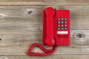 Vintage Red phone on old wood