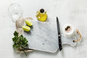 marble cutting board, spices, olive