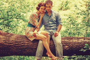 Loving couple sitting on tree