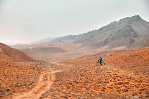 Man ride bicycle in the desert