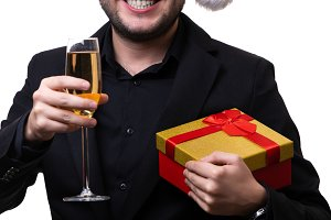 Image of man in Santa hat with gift