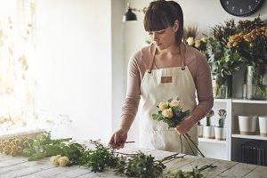 Female florist making a flower arran