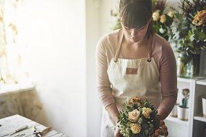 Florist working in her flower shop m