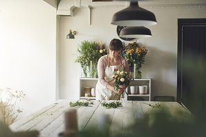 Young florist working in her flower