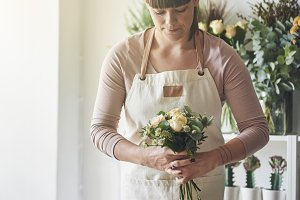 Young florist arranging a bouquet in
