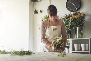 Young florist arranging a mixed flow
