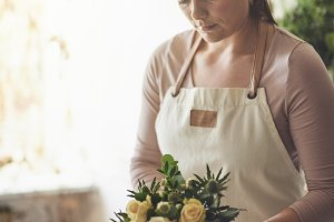 Female florist standing in her flowe