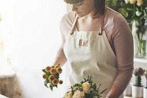 Florist making flower arrangements a