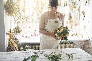 Florist working in her flower ship m