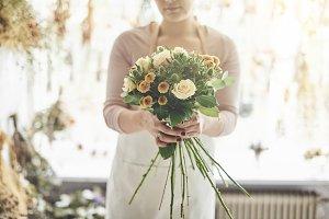 Female florist presenting a bouquet