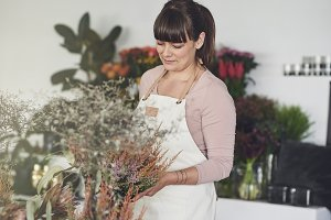 Smiling female florist working in he