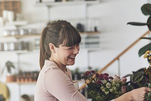 Laughing florist arranging a floral