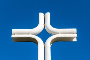 Modern iron cross on the sky