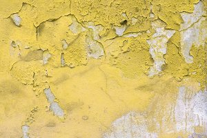 Old peeled yellow wall