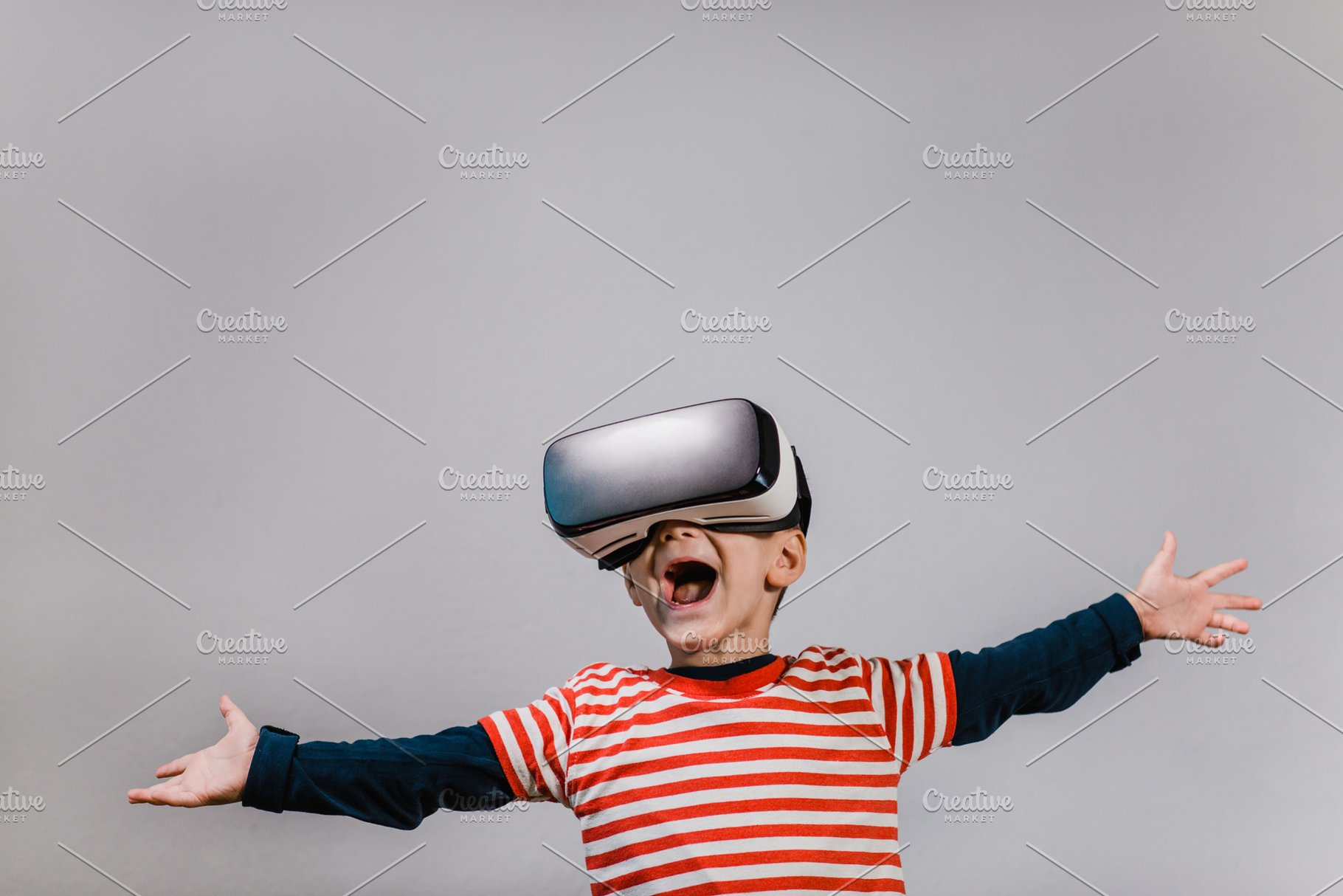 1811e4a4a848 Excited child wearing VR headset. ~ Technology Photos ~ Creative Market
