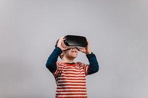 Boy wearing virtual reality headset.